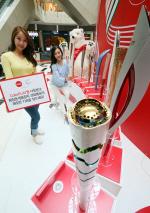 코카-콜라, 올림픽 성화봉송 투어